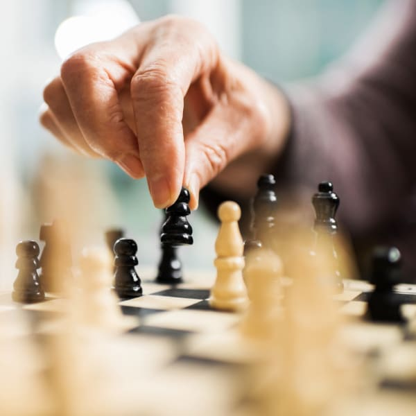 Playing chess at Pacifica Senior Living Sterling in Sterling, Virginia.