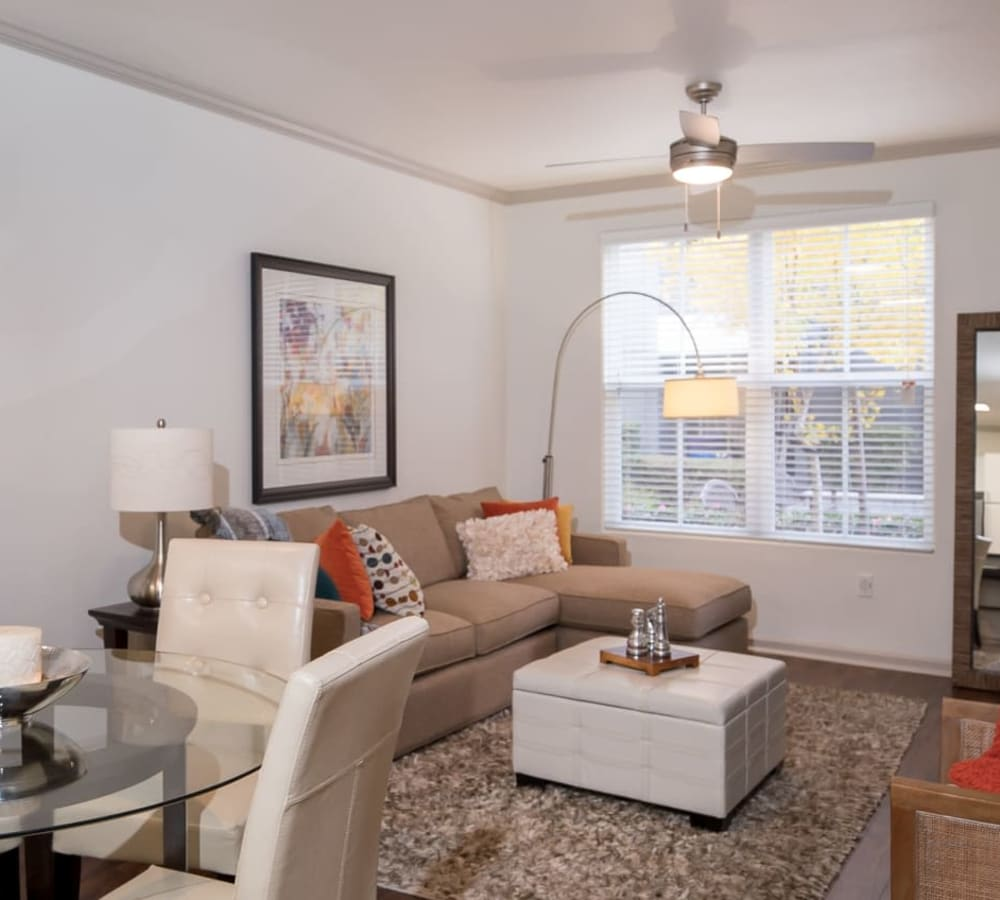 A spacious living room with a large window in a platinum home at Park Central in Concord, California