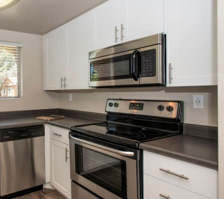 Luxury kitchen with wood-style flooring at Hidden Hills Condominium Rentals in Laguna Niguel, California