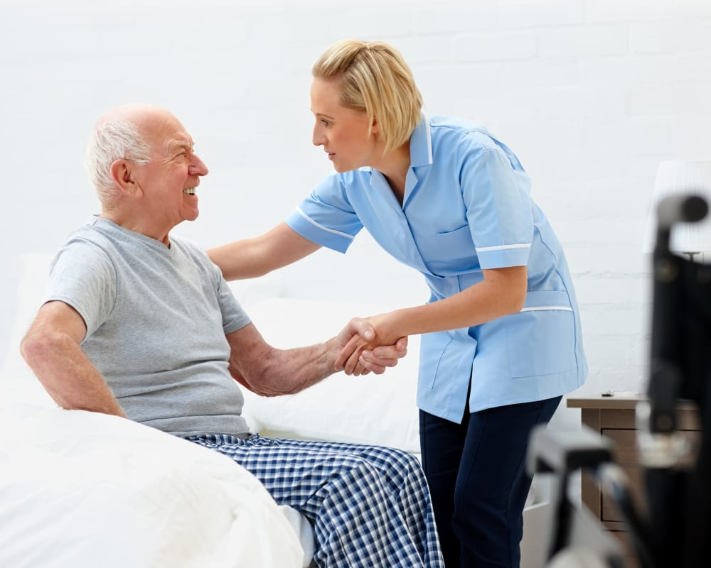 Staff helps resident out of bed at Holstein Senior Living in Holstein, Iowa.