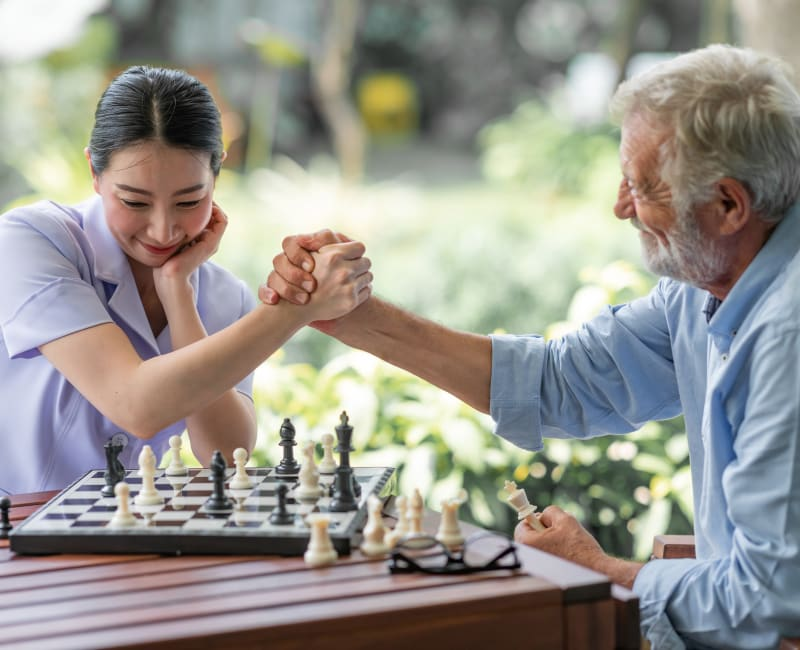 A volunteer playing chess with a resident at Ebenezer Ridges Campus in Burnsville, Minnesota.