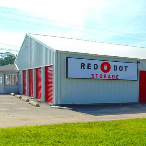 Outdoor storage units with Red Dot Storage sign at Red Dot Storage in Iowa City, Iowa