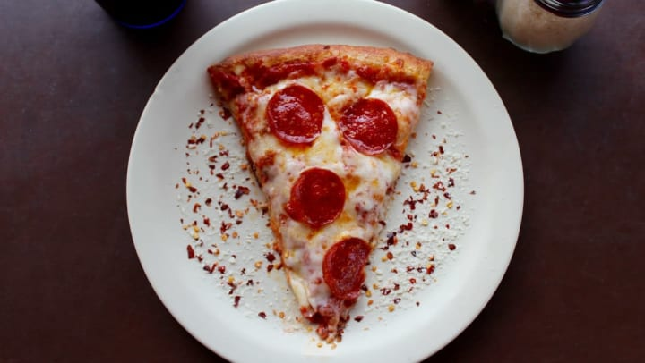 Slice of pepperoni pizza at Olympus Grand Crossing in Katy, Texas