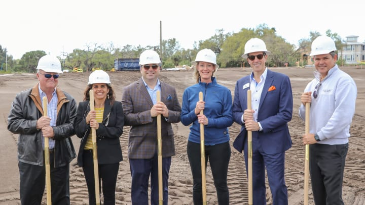 : Groundbreaking ceremony for the new Active Independent Living community at Discovery Village At Sarasota Bay. Pictured from left to right: Bo Russ (Architectural Concepts), Tammy Kaminski, Richard J. Hutchinson (Discovery Senior Living), Heather Henning (Henning Holdings), Bill Sciortino (Discovery Senior Living), Eric Center (Cedar Hammock Fire Rescue).