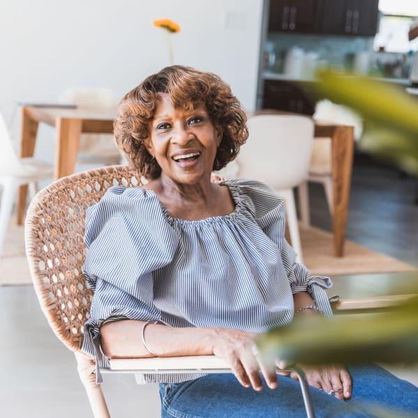 A resident smiling at Kenmore Senior Living in Kenmore, Washington.