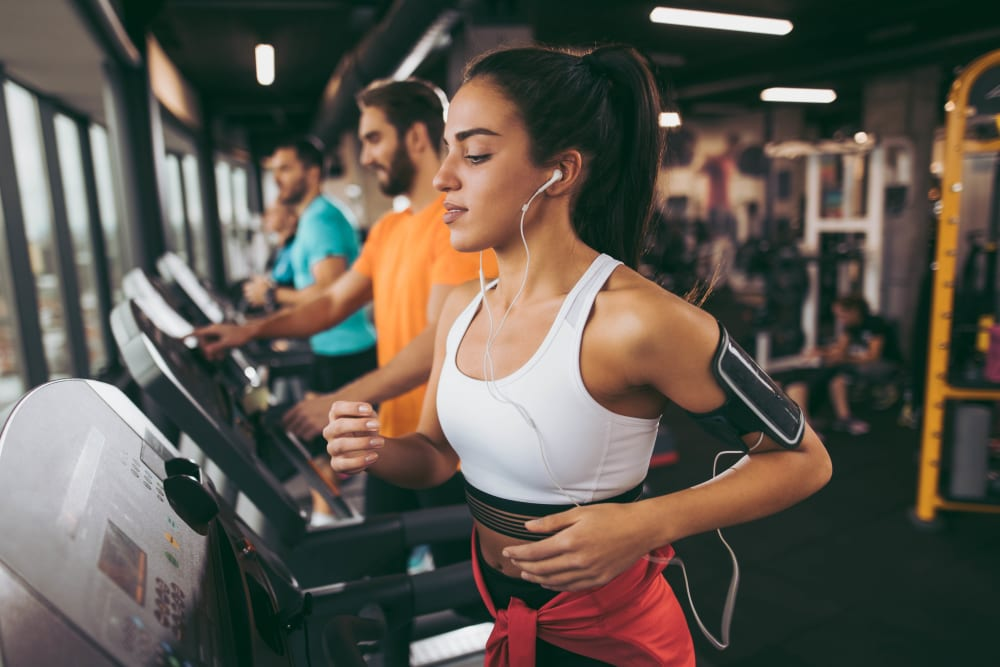 Resident running on the treadmill at the gym at Hidden Hills Condominium Rentals in Laguna Niguel, California