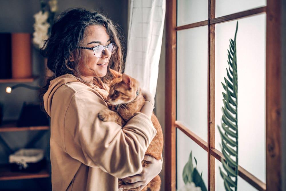 Resident holding her cat at Oaks Braemar in Edina, Minnesota