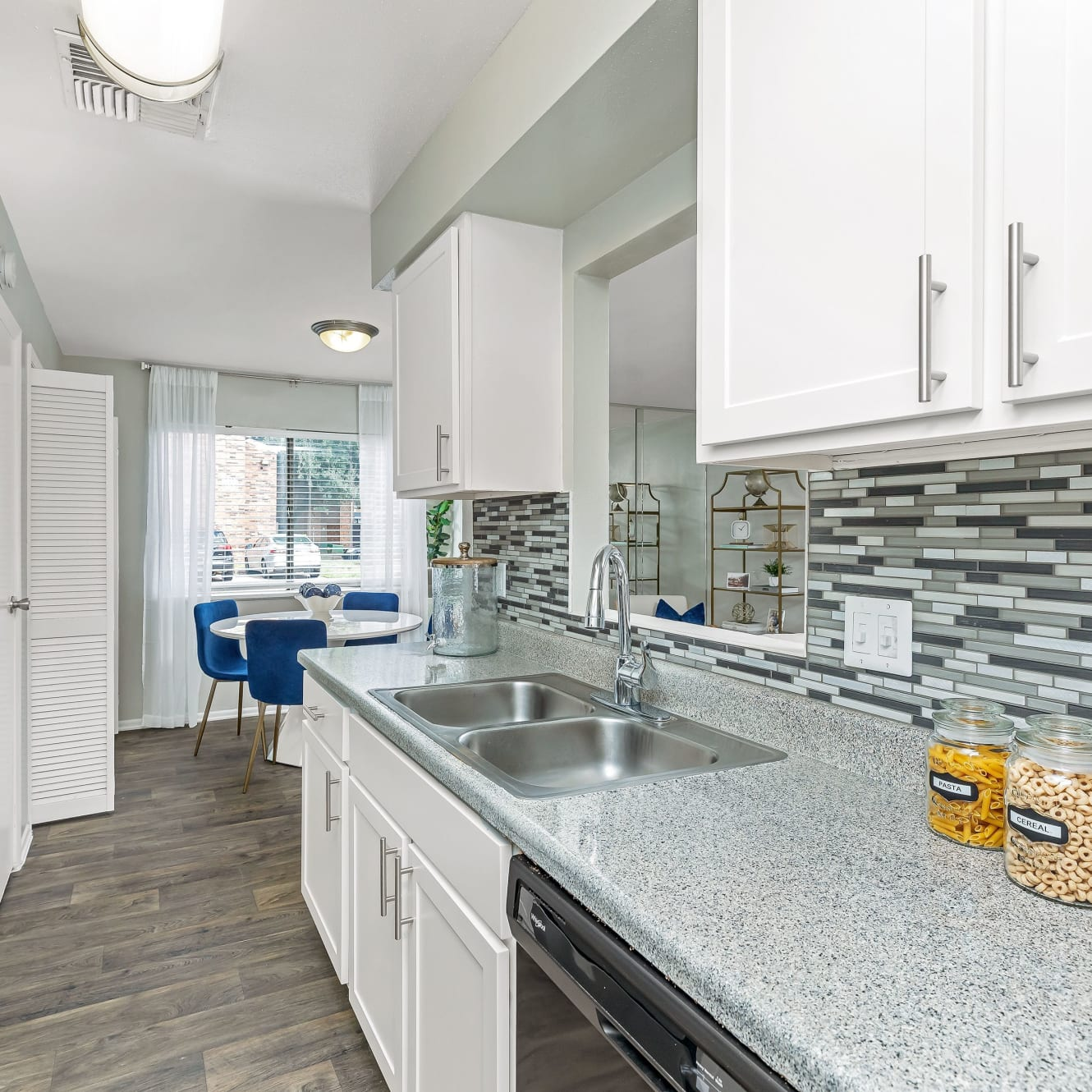 An expansive kitchen with a stainless-steel sink at Barringer Square in Webster, Texas