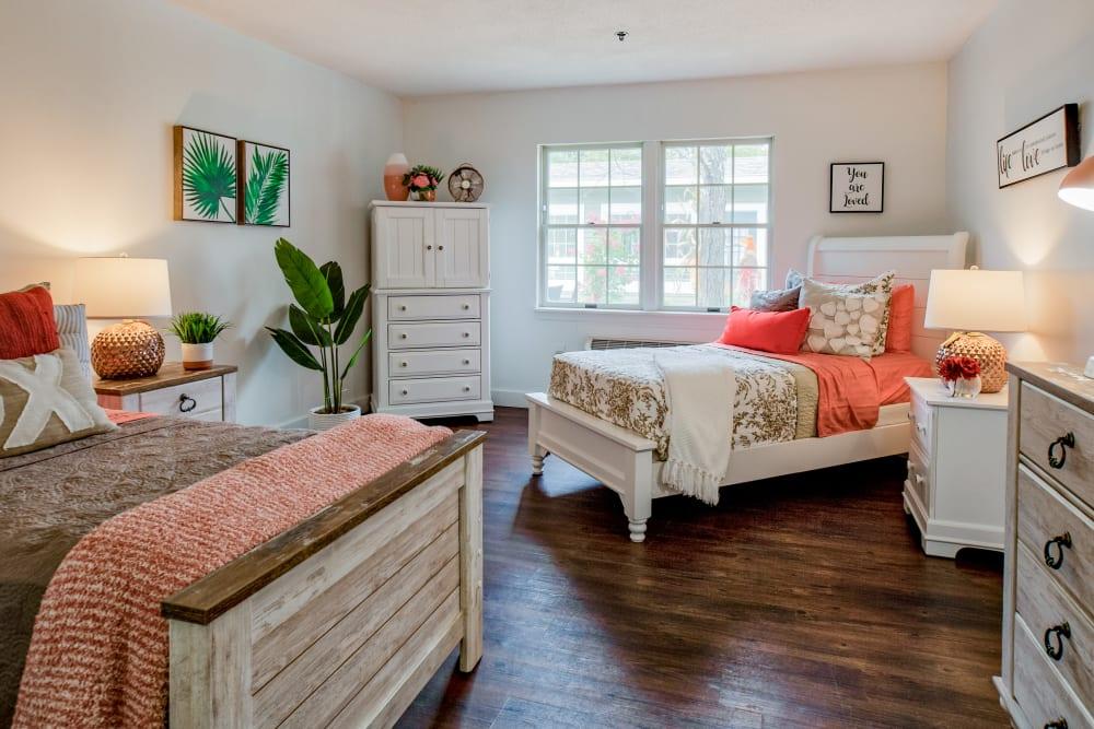 Beautiful hardwood floors in bedroom at Wood Haven Senior Living in Tewksbury, Massachusetts