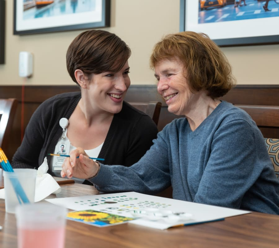 A resident painting at Touchmark at Fairway Village in Vancouver, Washington