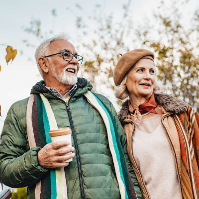 A resident couple taking a walk at Logan Creek Retirement Community in Mount Vernon, Washington