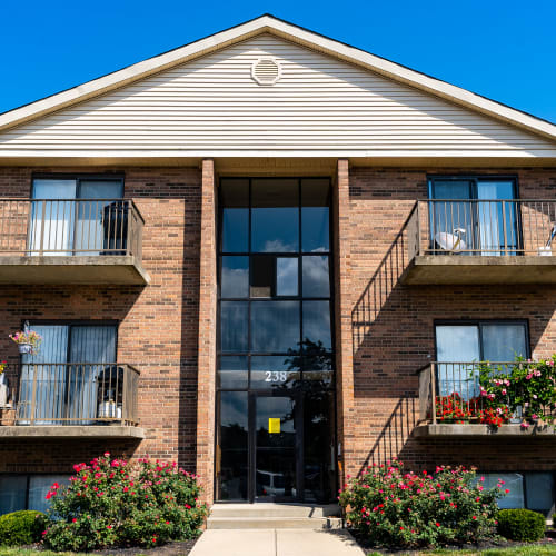 Exterior with private balconies at Indian Footprints Apartments in Harrison, Ohio