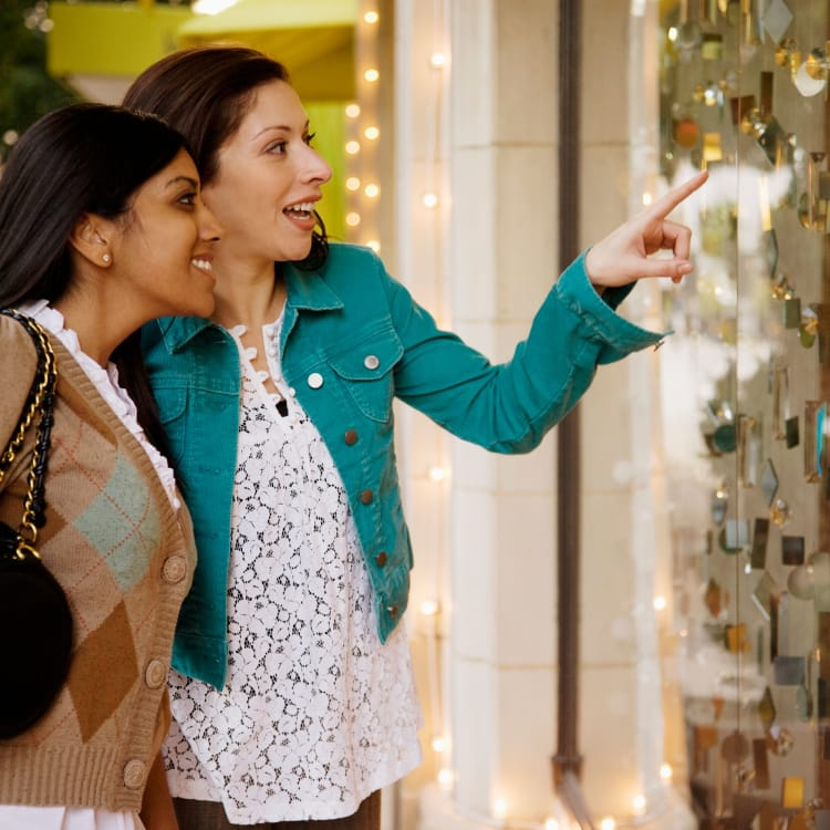 Two women shopping at Park Apartments