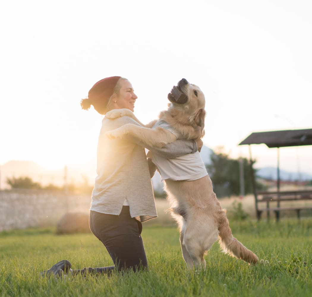 Woman and her happy pup at the park near Commonwealth at 31 in Spring Hill, Tennessee