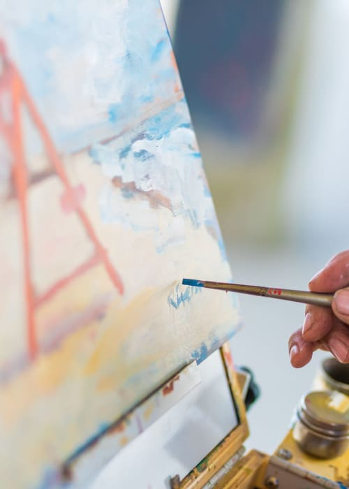 Resident painting at Sunstone Village in Denton, Texas