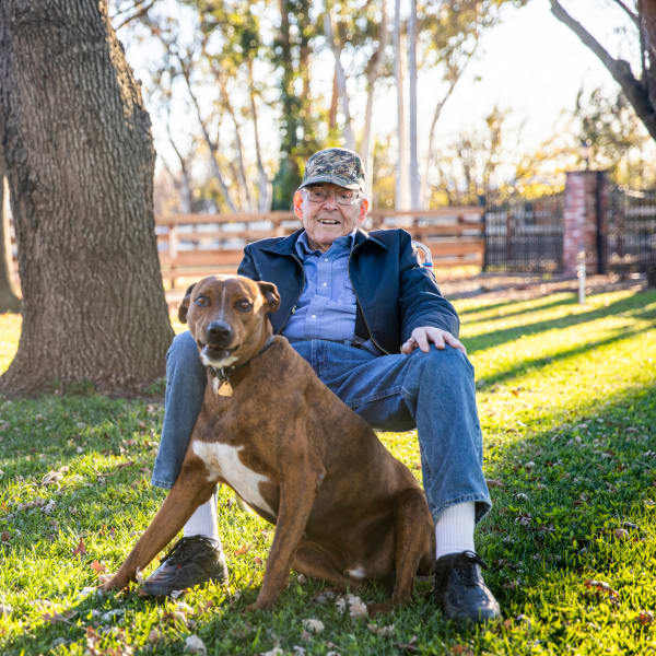 A resident and his dog at The Atrium at Carmichael in Carmichael, California.
