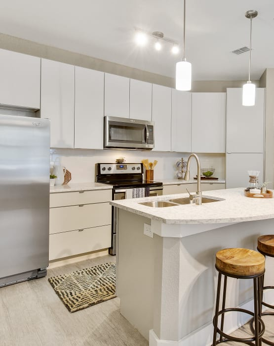 Modern kitchen with stainless steel appliances at Steele Creek in Jacksonville, Florida