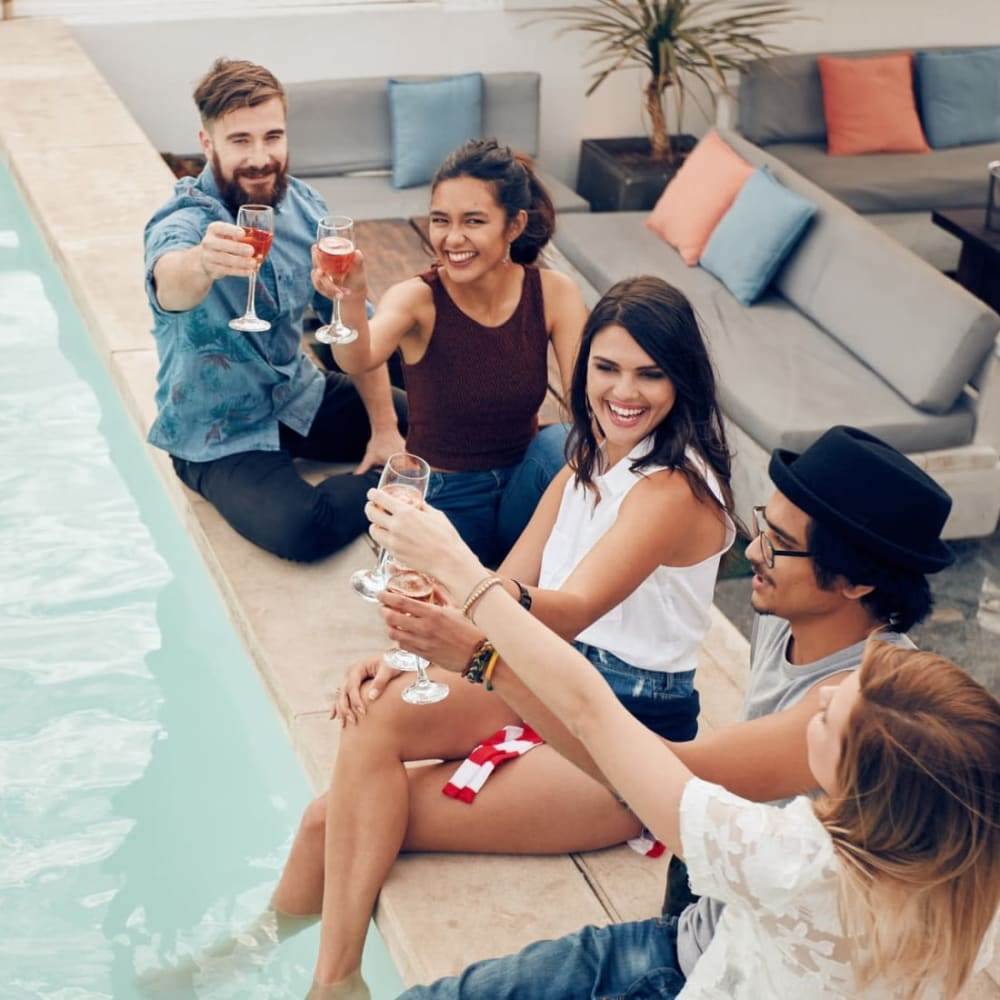 Residents raising a toast to the good life at the resort-style swimming pool at Abaco Key in Orlando, Florida