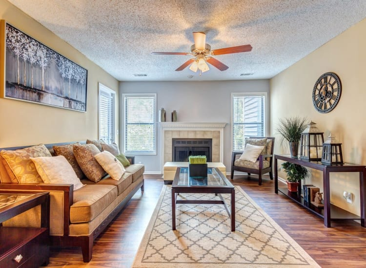 Open-concept living area with hardwood floors and ceiling fan in model home at Lyric on Bell in Antioch, Tennessee
