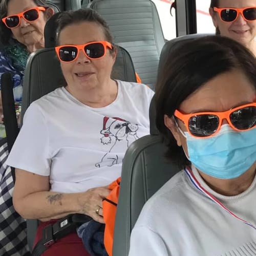 Residents on the bus at The Oxford Grand Assisted Living & Memory Care in McKinney, Texas