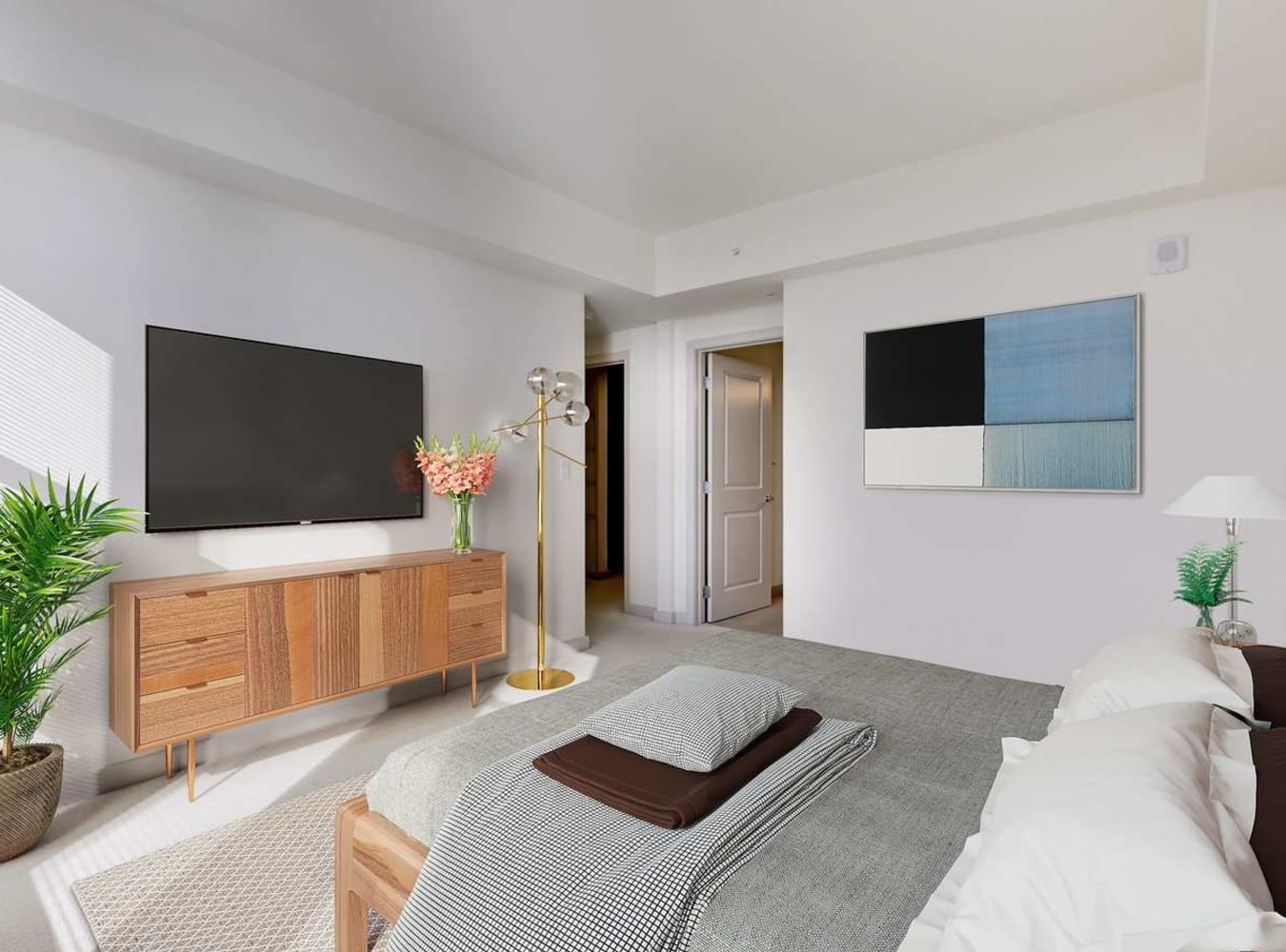 The main bedroom with large windows at Solaire 7077 Woodmont in Bethesda, Maryland