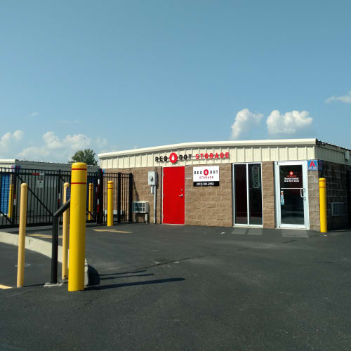 Rental center at the gated entrance to Red Dot Storage in New Albany, Indiana