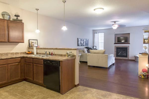 Apartment kitchen and living room at Ironwood in Altoona, Iowa