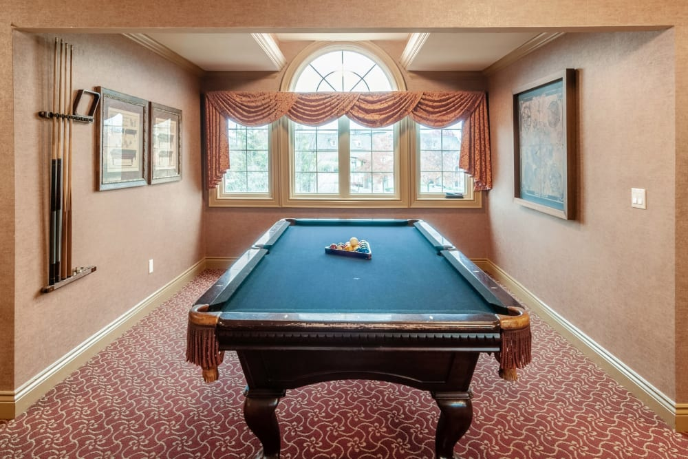 A game room with billiard table at Central Park Estates in Novi, Michigan