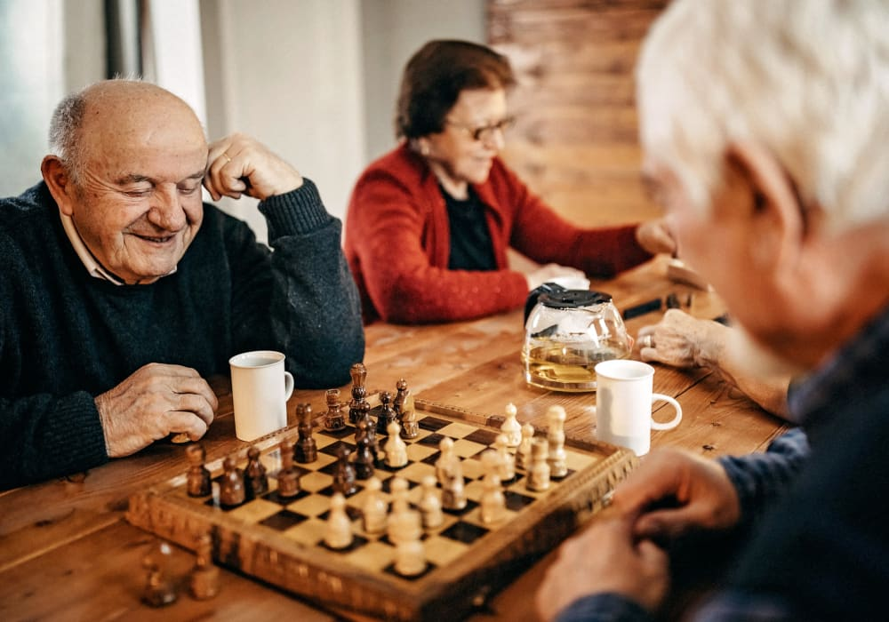 Residents playing chess at Bridgeport Place Assisted Living in University Place, Washington.