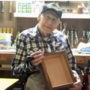 Resident Harold making memory boxes for his Dare to Dream event at Milestone Senior Living in Eagle River, Wisconsin