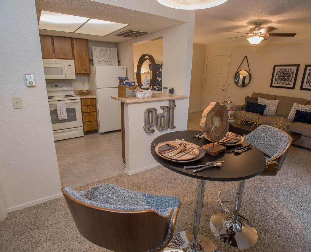 Bright kitchen and dining room at Woodscape Apartments in lOklahoma City, Oklahoma