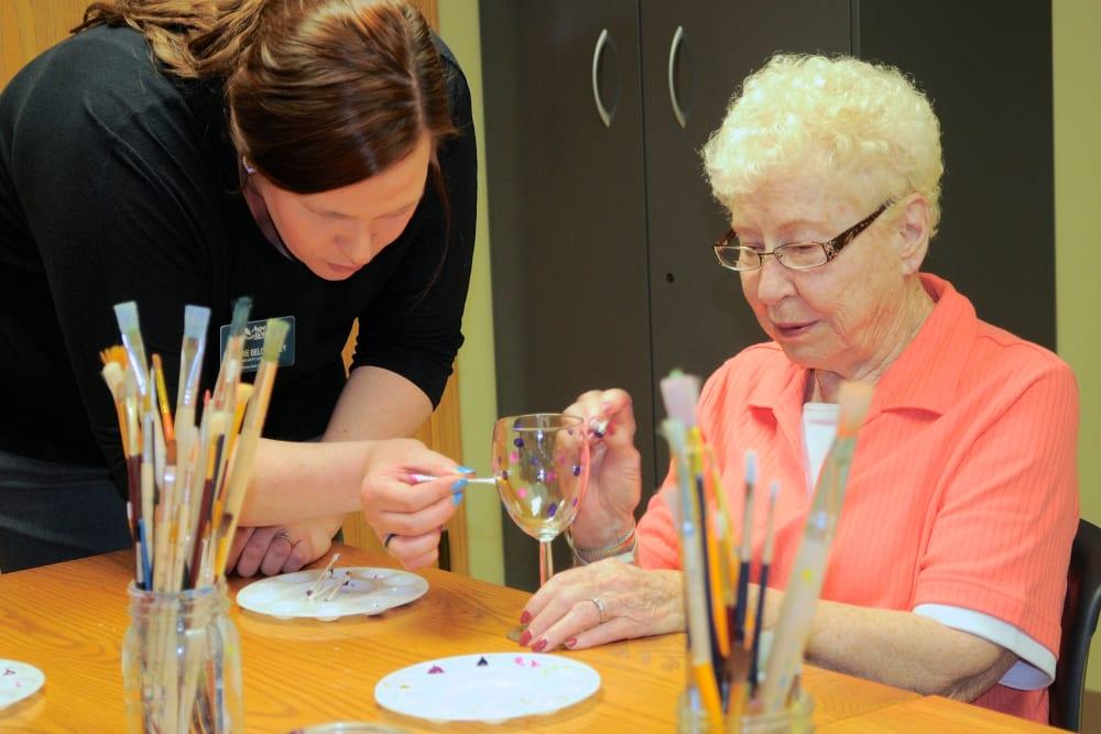 Senior resident enjoying an art class
