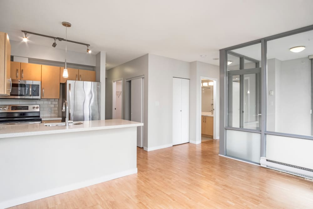 Living Room & Kitchen at Bayview at Coal Harbour in Vancouver, British Columbia