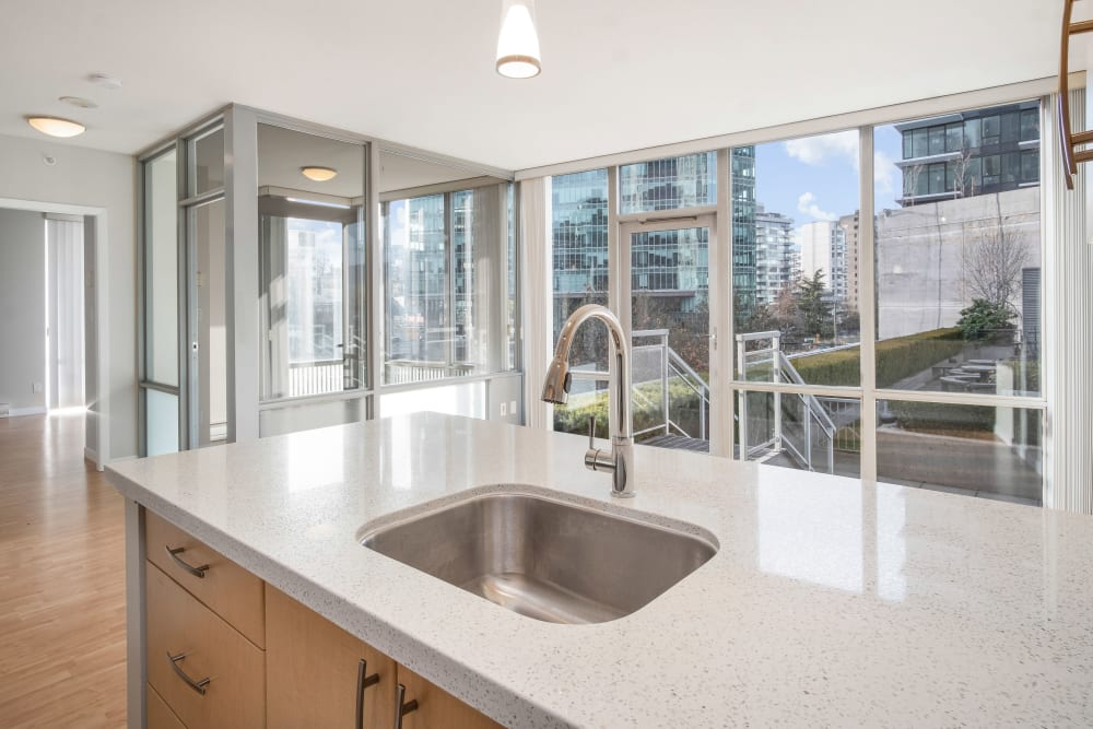 Kitchen w/ Cooking Island at Bayview at Coal Harbour in Vancouver, British Columbia