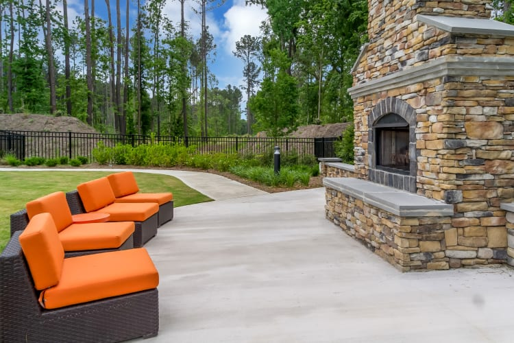 Lounge area by Lullwater at Blair Stone's outdoor fireplace in Tallahassee, Florida