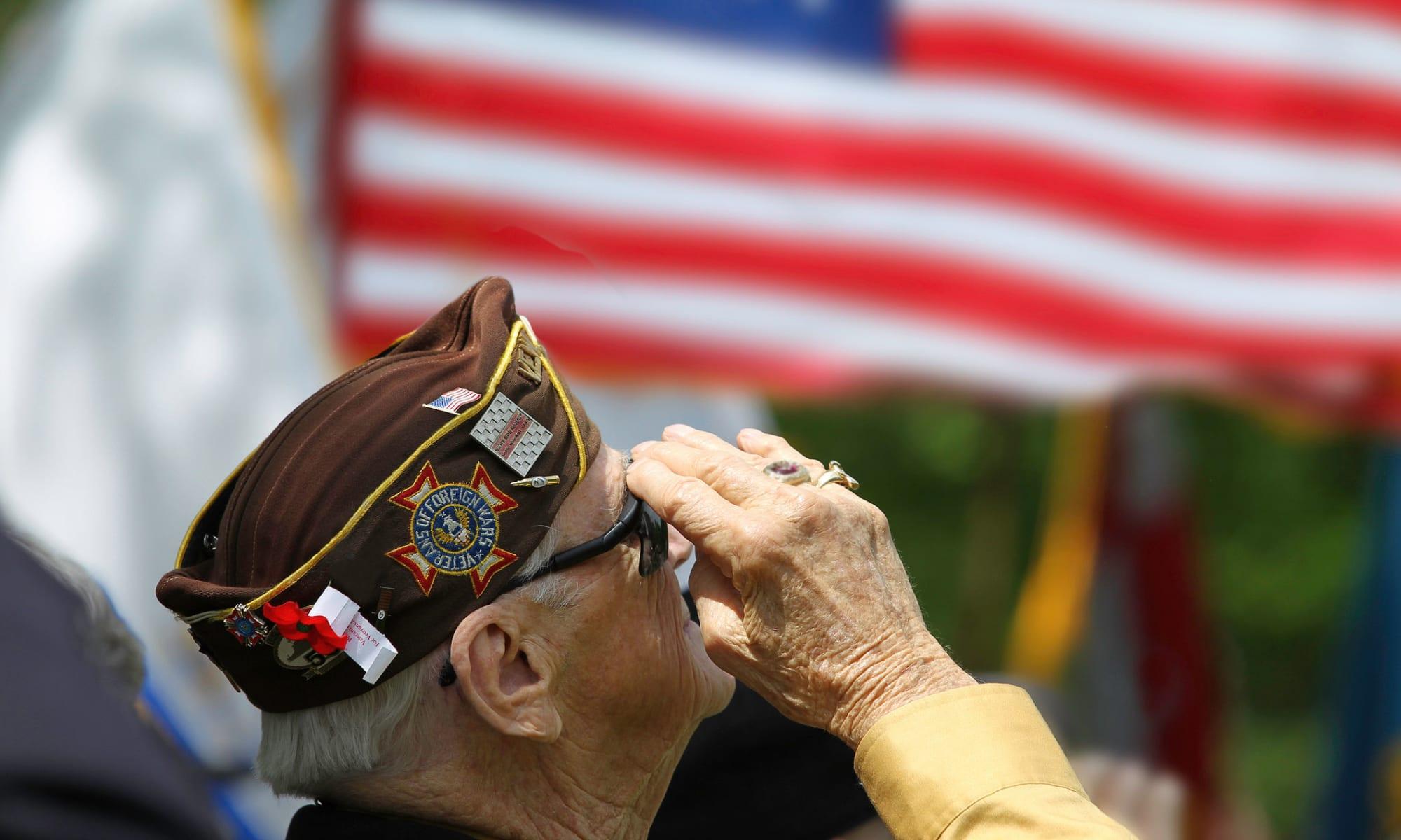 A veteran salutes the flag at Broadwell Senior Living in Kearney, Nebraska