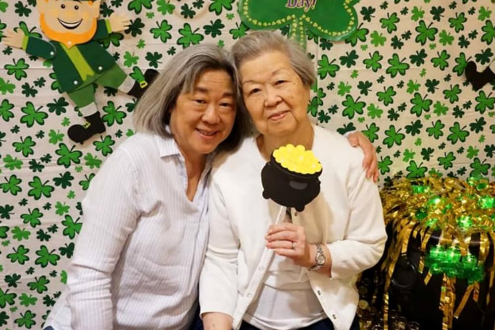 Resident posing for a photo at Campus Commons Senior Living in Sacramento, California