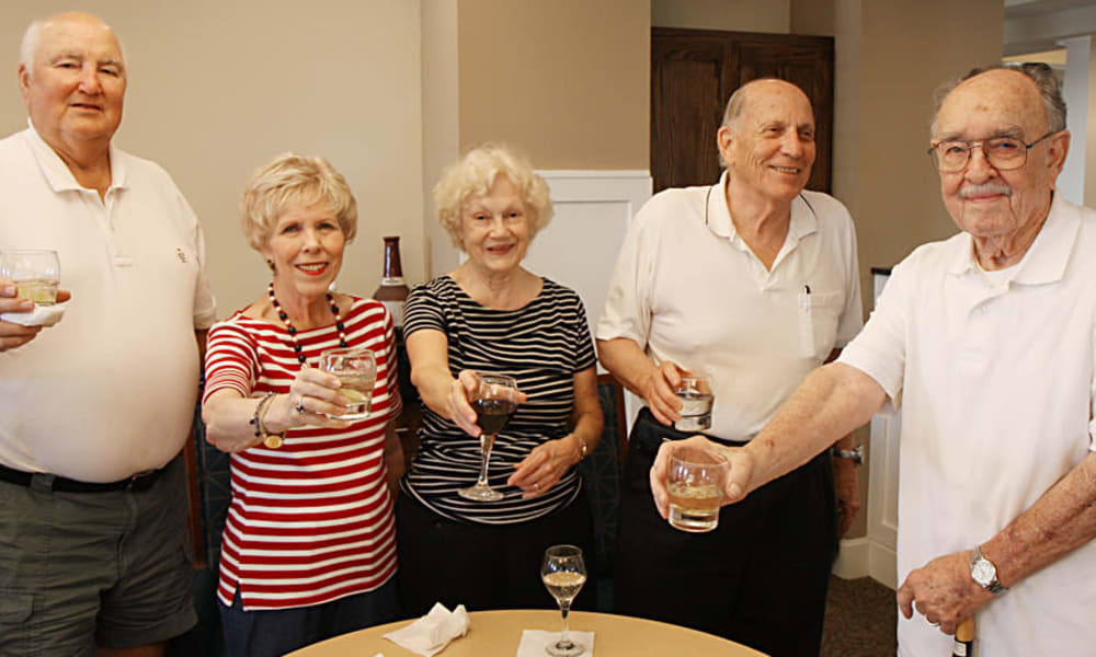 Group of 5 residents toasting at MacArthur Hills in Irving, Texas