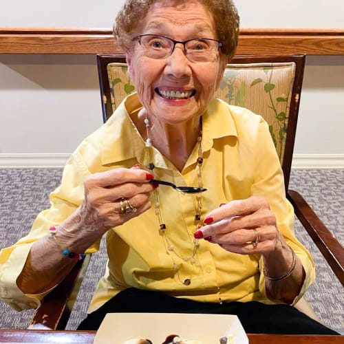 Resident eating ice cream The Oxford Grand Assisted Living & Memory Care in Wichita, Kansas