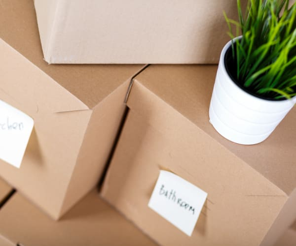 A stack of packed and labeled boxes at Airport Road Storage in Monterey, California