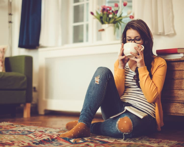 Resident relaxing with a cup of tea in her new home at Haven Martinez in Martinez, California