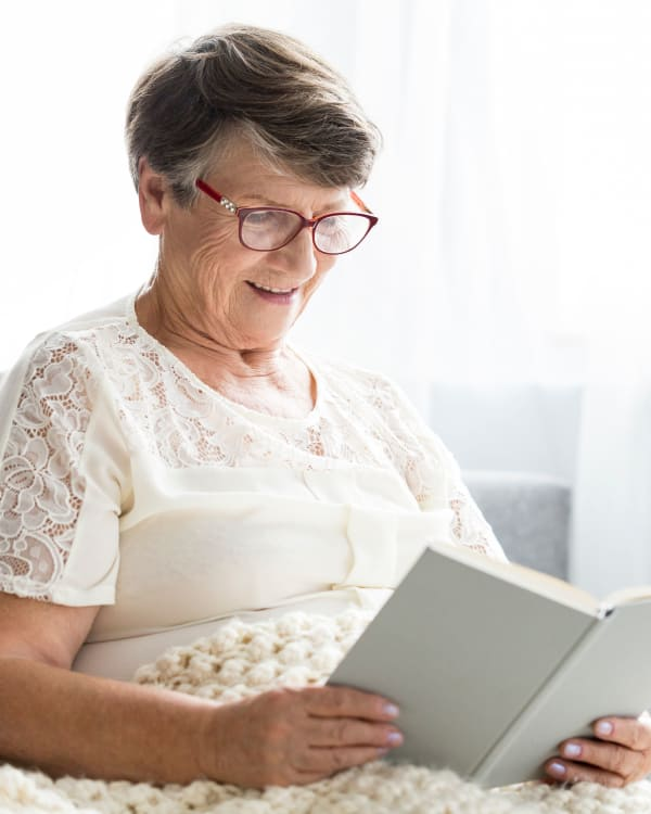 A woman reading a book at Trilogy Health Services in Louisville, Kentucky
