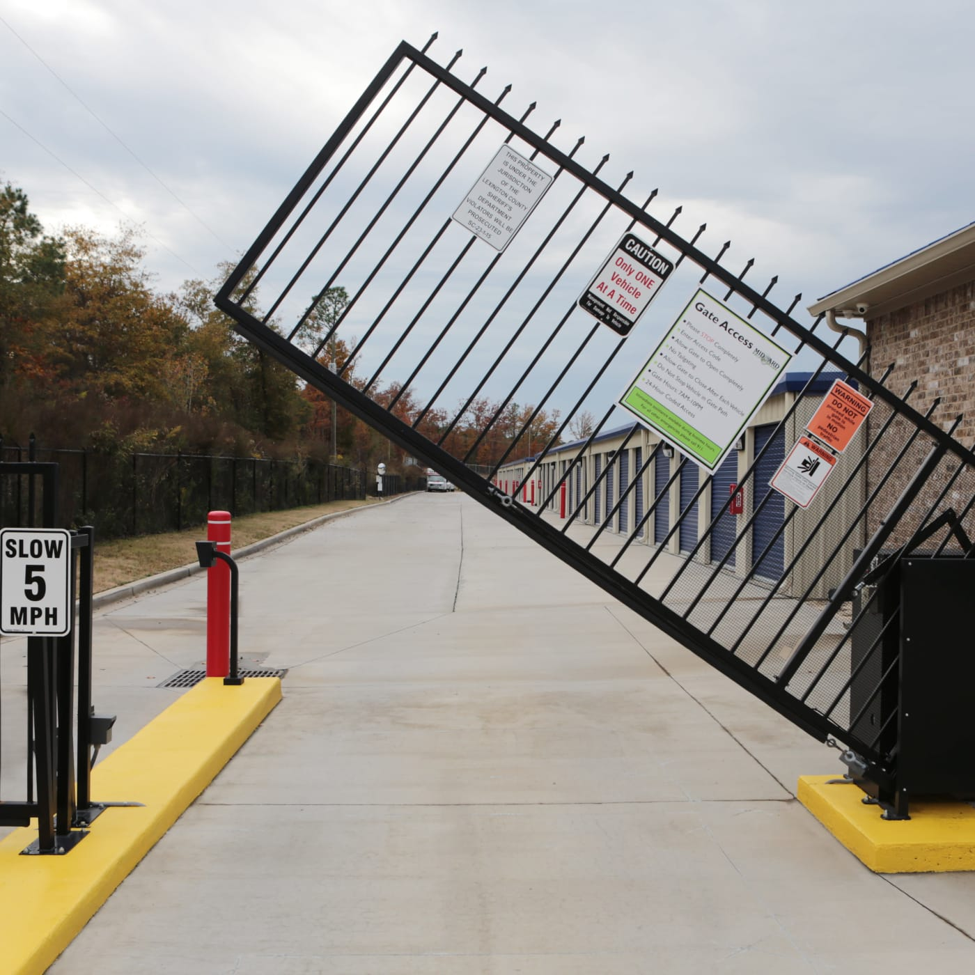Raised gate entrance to Midgard Self Storage in Lexington, South Carolina