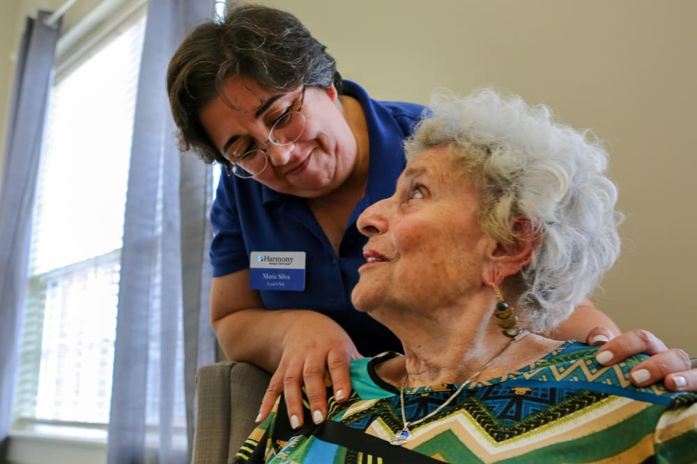 A resident and caretaker at Harmony at Harbour View in Suffolk, Virginia