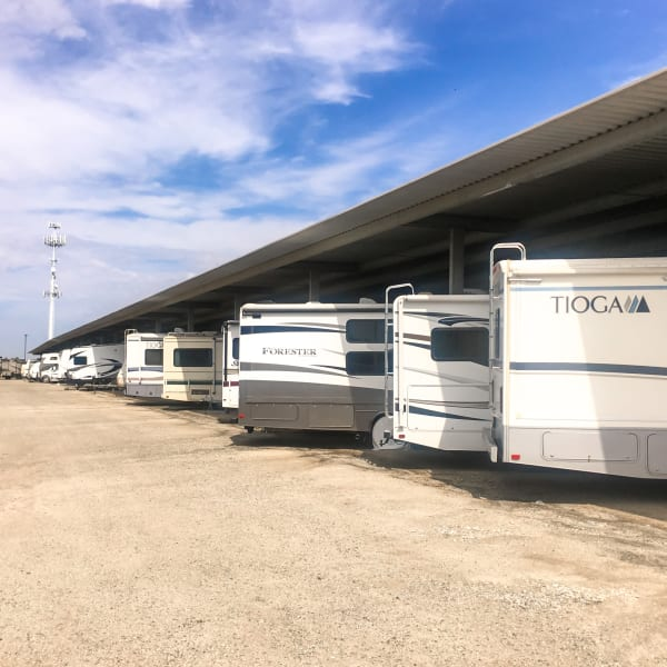 Covered RV, boat, and auto storage at StorQuest RV and Boat Storage in Moreno Valley, California