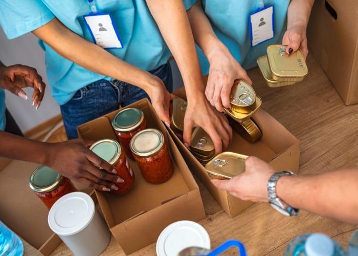 Otay Crossing Self Storage in San Diego, California staff preparing a food donation box