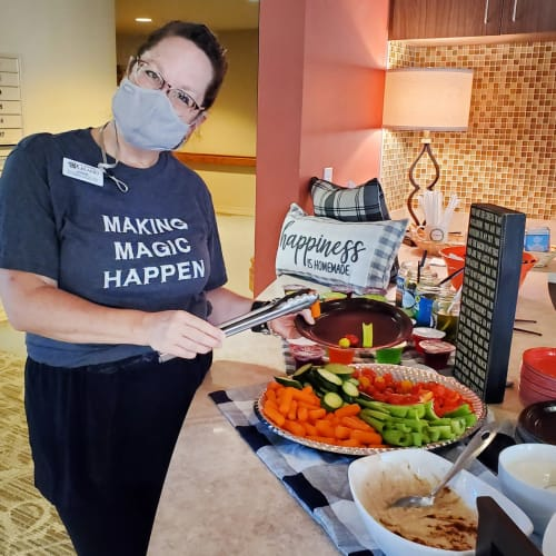 Happy masked caretaker at The Oxford Grand Assisted Living & Memory Care in Wichita, Kansas