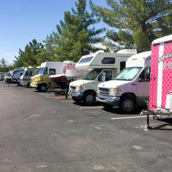 RVs, boats, and trailers parked at StorQuest Self Storage in Tempe, Arizona