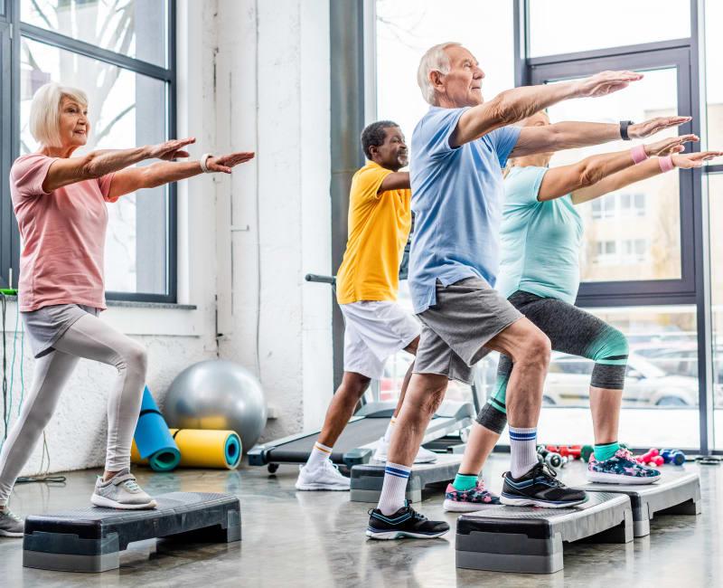 Residents at a step fitness class at Arbor Glen Senior Living in Lake Elmo, Minnesota