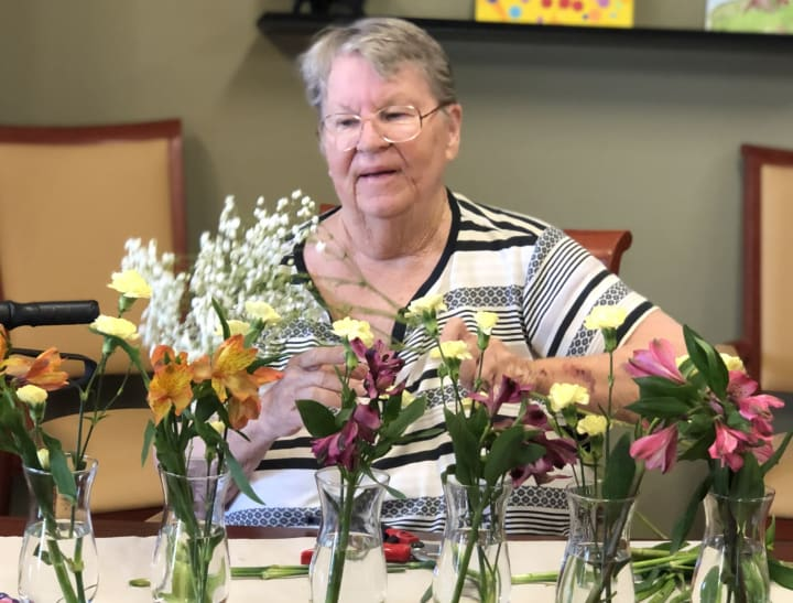 The Oaks resident puts together some wonderful arrangements during flower arranging club.